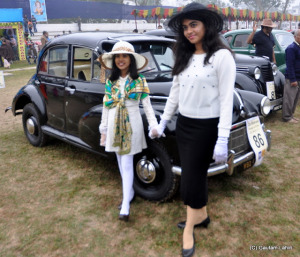 Excited and happy, dressed in European attire, young ladies proudly stand beside a 1946 Morris and 1946 Renault, one is an 800 cc, 4 cylinder engine standing beside 1003 cc, 4 cylinder beauty  at Kolkata, West Bengal, India by Gautam Lahiri