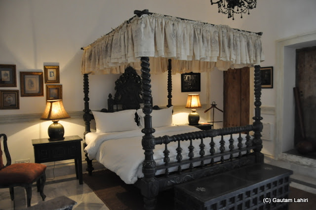 A four-poster bed, design which dates back to perhaps, 100-150 years back adorn one of the living rooms at Bawali Rajbari, Kolkata, West Bengal, India by Gautam Lahiri
