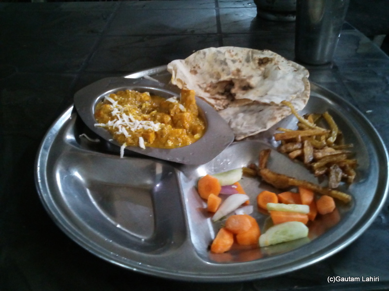 At Gaya, A vegetarian dinner that I had ordered when the bus stopped. It comprised of handmade bread, a mixed salad of carrots, cucumber, a big spoon filling crispy potato slices, and shahi paneer, incredibly tasty at Gaya by Gautam Lahiri