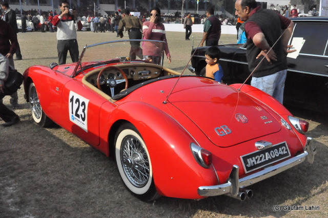 1961 Midget (MG) Sports Roadster snatched everyone's attention with her sensuous curves. The 1.5L, B Series I4 engine had a growl of a tigress  at Kolkata, West Bengal, India by Gautam Lahiri
