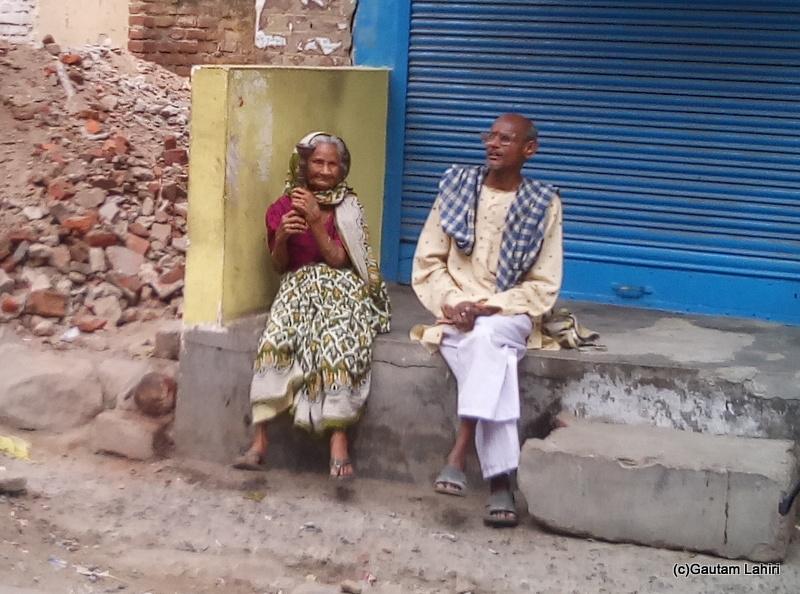 At Gaya, Elderly woman having hookah on the streets of Gaya by Gautam Lahiri