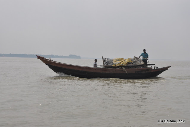 Fishermen returning with their morning catch on Rupnarayan river at Gadiara, Hooghly, West Bengal, India by Gautam Lahiri