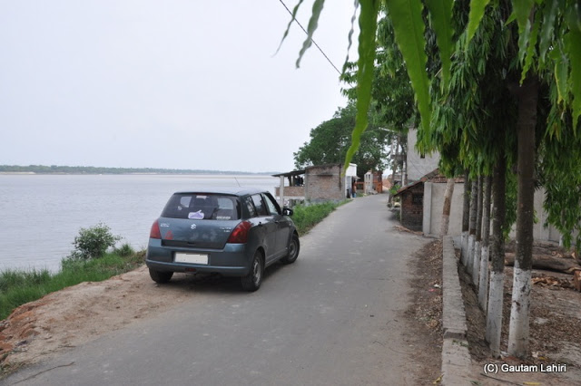 We parked almost at the edge of the land mass where the river started to keep enough room for another car to pass at Taki, West Bengal, India by Gautam Lahiri