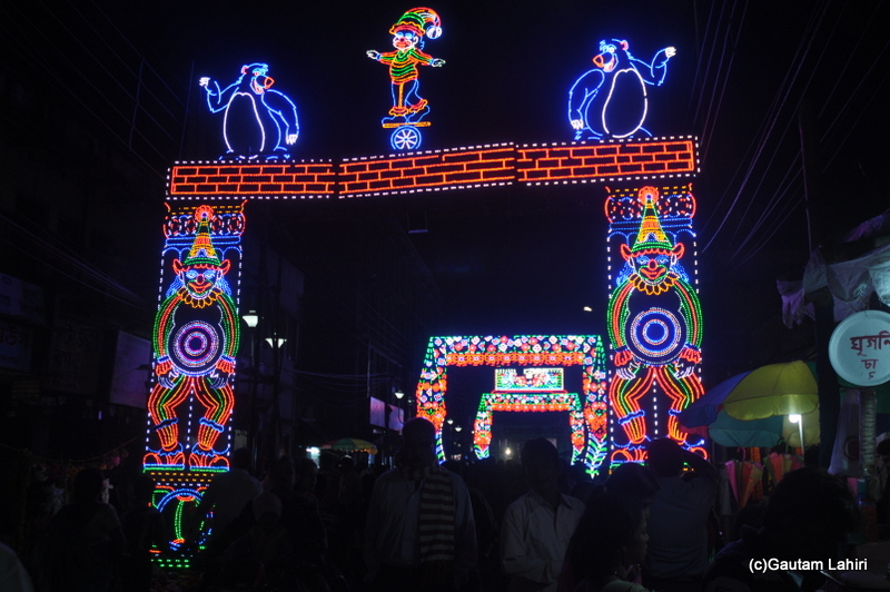 Electric artwork that adorns the streets with about a million people visiting the pandals in Chandannagar by Gautam Lahiri
