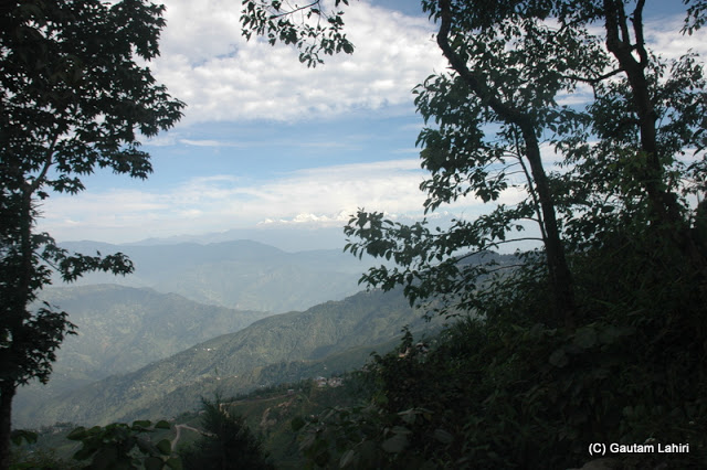 As the day grew older, the clouds thickened, slowly blanking Khangchendzonga as we saw the range through the forest at Darjeeling, West Bengal, India by Gautam Lahiri