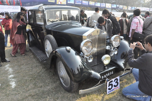 The black 1938 Rolls Royce Wraith 4.2 liters, 6 cylinders looked incredibly beautiful in the morning sunrise  at Kolkata, West Bengal, India by Gautam Lahiri