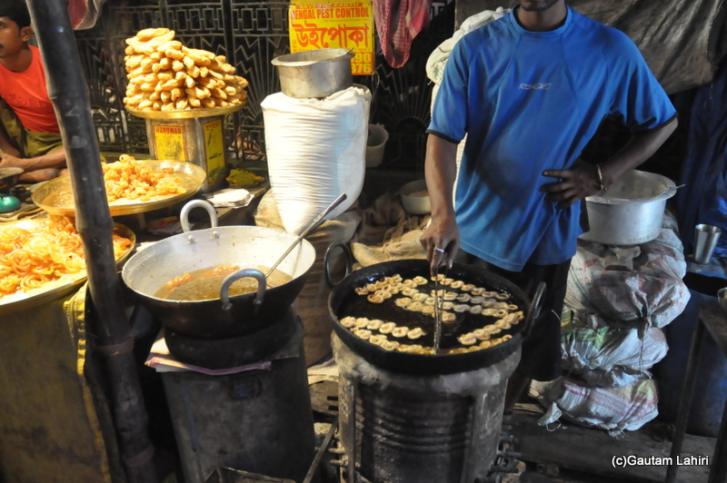 Foods of various kinds, mainly sweets awaited the clients to gorge them to their heart's content in Chandannagar by Gautam Lahiri