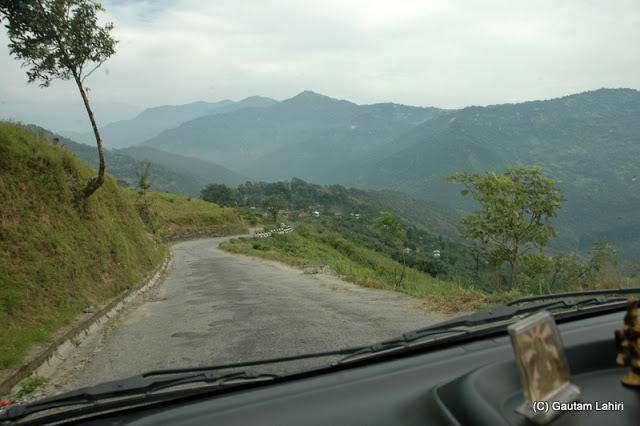 Road to Kalimpong, quite smooth over the hills snaking its way through the mountains  at Darjeeling, West Bengal, India by Gautam Lahiri