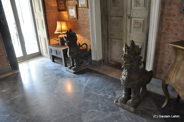 Metal dragons adorned the polished floors at Bawali Rajbari, Kolkata, West Bengal, India by Gautam Lahiri