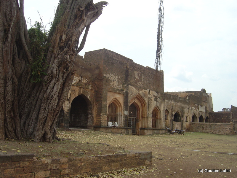 Front face of the Tarkash Mahal, the walls that had protected the privacy of the Turkish wives now lay mute and still try to tell the history to the visitors with silence at Bidar fort by Gautam Lahiri