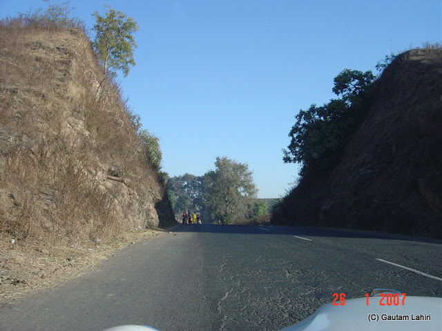 The hill sliced with a cleaver for the motorists to have a singular experience of the road to Kanha from Nagpur by Gautam Lahiri
