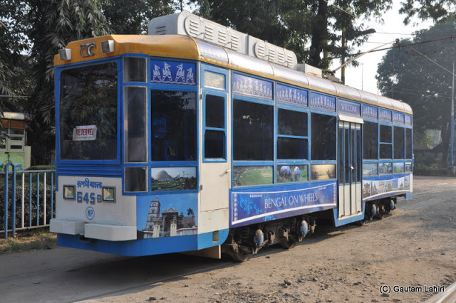 A Calcutta Tramways decorated single compartment tram parked at Esplanade tram terminus, Kolkata, West Bengal, India by Gautam Lahiri