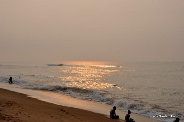 Sun shimmering over the sea all the way to the horizon  at Puri, Bhubaneshwar, Odisha, India by Gautam Lahiri
