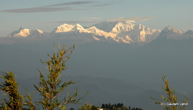 Every second the mountain changed its color.. it was gold, then was it crimson? or white. The clouds, the wind and all the forces of nature were playing around  at Darjeeling, West Bengal, India by Gautam Lahiri