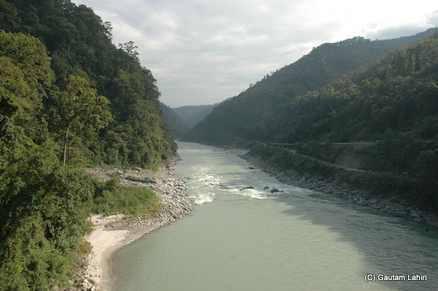 Crossing the Teesta river and stopping to take a break to see the fast-moving river water splashing against the rocks that shoulder the banks  at Darjeeling, West Bengal, India by Gautam Lahiri