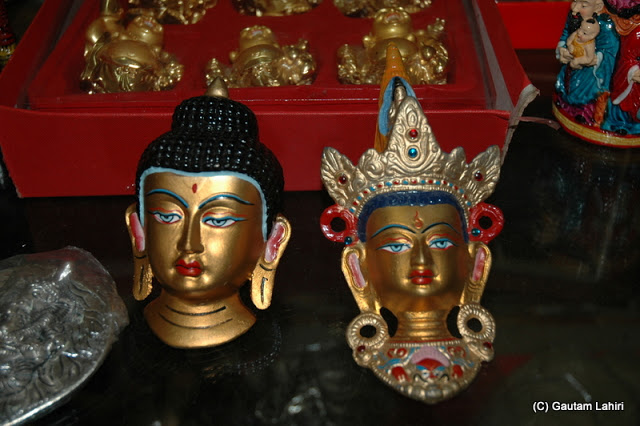 Buddha heads, with intricate designs on display  at Darjeeling, West Bengal, India by Gautam Lahiri