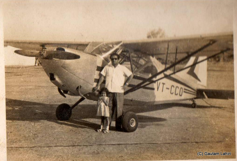 My father with my sister, standing beside the petite Piper Cub PA 17, after their maiden flight over the city of Nagpur, India by Gautam Lahiri