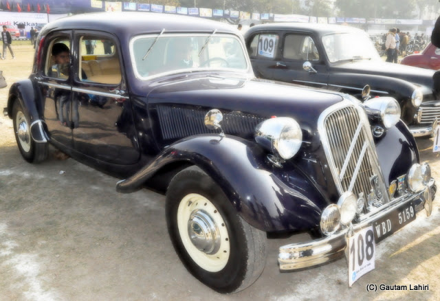 Polished clean, this 1952 Citroen 15 pulled a huge crowd and engine note was almost that of a leopard, ready to leap, this car was famous for its traction avant monocoque design  at Kolkata, West Bengal, India by Gautam Lahiri