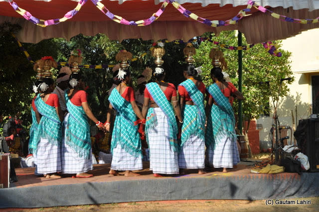 Tribal women happily dancing on the stage  at Santiniketan, West Bengal, India by Gautam Lahiri