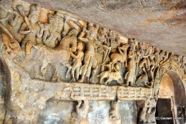Partly damaged but more or less intact, a victory scene in one of the caves where we saw figures of soldiers with bows and arrows pushing a horse coming back from a battle  at Bhubaneshwar, Odissa, India by Gautam Lahiri