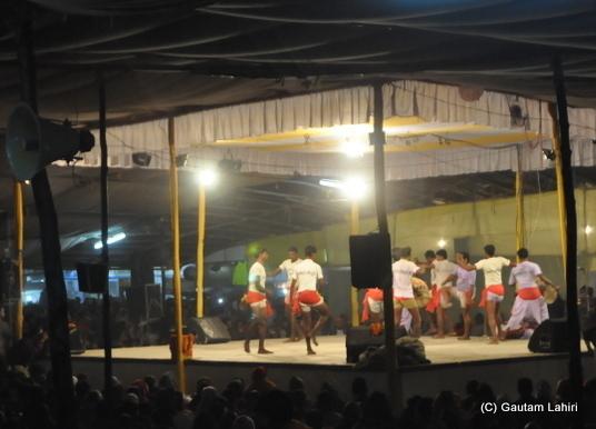 Tribal dance in full wing at poush mela at Santiniketan, West Bengal, India by Gautam Lahiri