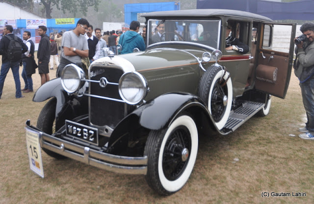 Onlookers are mesmerized by the beauty of this 1928 Studebaker  at Kolkata, West Bengal, India by Gautam Lahiri