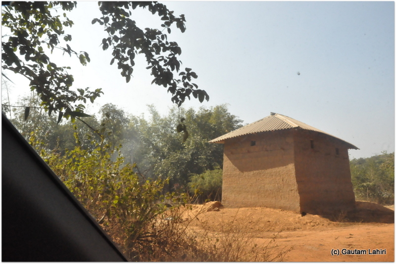 A lone mud house was all that we could see among the dense jungle on Joypur jungle, Bankura by Gautam Lahiri