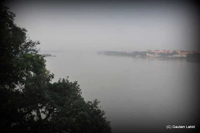 The Hooghly river calmly flows and patiently awaits the big ferries that will cross her when Calcutta and Howrah want to connect  at Kolkata, West Bengal, India by Gautam Lahiri