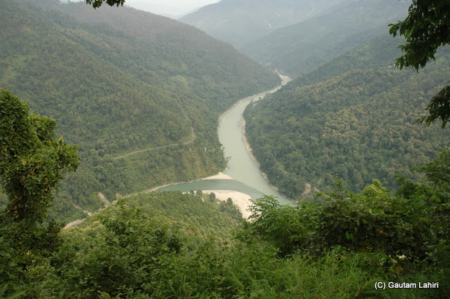 The confluence of Teesta river and Rangeet river, The spot from where we took this snap was picture perfect. Two rivers meandering through the dense jungles over the hills. All you can hear is the distant roar of the rivers and sound of the wind  at Darjeeling, West Bengal, India by Gautam Lahiri