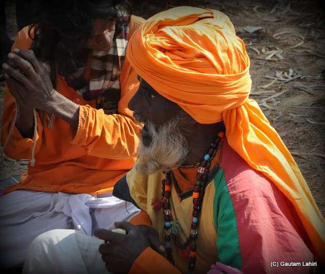 Another Baul singer accompanies his master  at Santiniketan, West Bengal, India by Gautam Lahiri