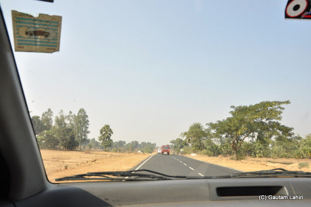 The road in this section was smooth as a silk and the car unlike the dancing session she had was stable and we increased our gallop to cover more distance   at Massanjore, Jharkhand, India by Gautam Lahiri