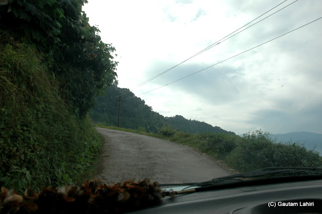 Hillside driving.. which one to see, the beautiful scenery around you through the windows or the road ahead  at Darjeeling, West Bengal, India by Gautam Lahiri