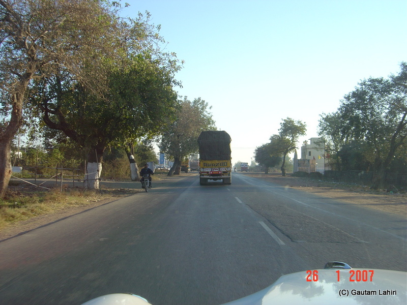 A single truck was all that remained in front of us. The broad road was too inviting to step on the gas which we did to cover the 257 kilometers to Kisli towards Kanha forest reserve by Gautam Lahiri