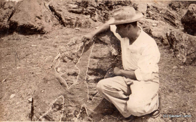 My father, Dinabandhu Lahiri, marking the rocks for geological study at Bageshwar, Uttarakhand, India by Gautam Lahiri