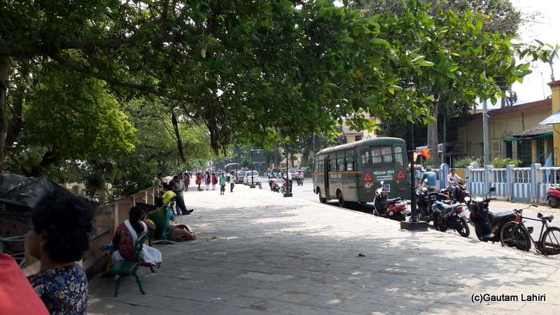 Chandannagar Strand, bustling with activities. Restaurants, old houses, colleges, and people lazily sitting on the iron benches relished the riverside by Gautam Lahiri