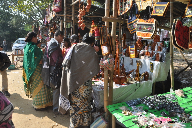 Buyers surround the handicraft stalls  at Santiniketan, West Bengal, India by Gautam Lahiri