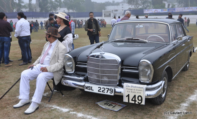 1967 Mercedes Benz 230S, with her proud owner, waits for the rally marshal to turn her 2.3 Litre motor  at Kolkata, West Bengal, India by Gautam Lahiri