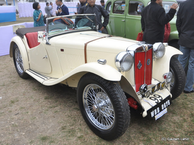 An off-white 1948 Midget, small British two-seater attracted considerable crowd with her neat and compact design  at Kolkata, West Bengal, India by Gautam Lahiri
