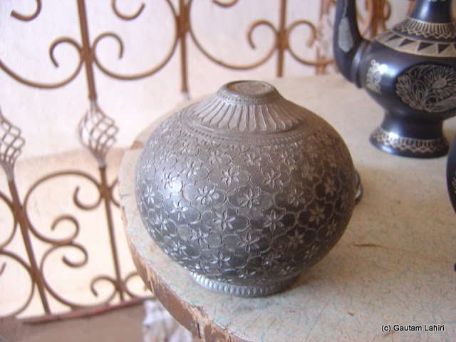 """The base of a """"Hukka"""" pot, finely sculpted and stands out before the Bidar fort's dust filled its indentations with a blackish glow by Gautam Lahiri"""