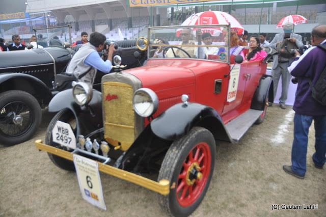 A 1922 Austin is all set to take its passengers effortlessly with its 12 HP, 4 cylinder engine  at Kolkata, West Bengal, India by Gautam Lahiri