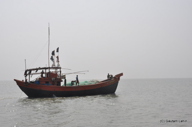 Fishing boat in Bay of Bengal at Frasergunj, Bakkhali beach, West Bengal, India near Bay of Bengal by Gautam Lahiri
