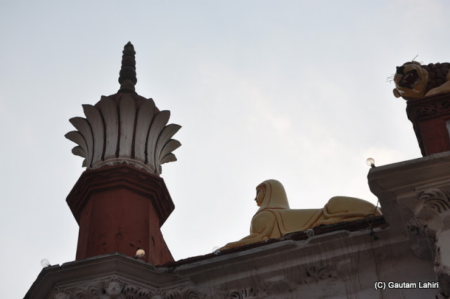 An interesting design mix atop the entrance..minarets and a shape looking quite similar to Blue Amenhotep III Sphinx Egyptian figure adorned the rooftop at Krishnanagar, West Bengal, India by Gautam Lahiri