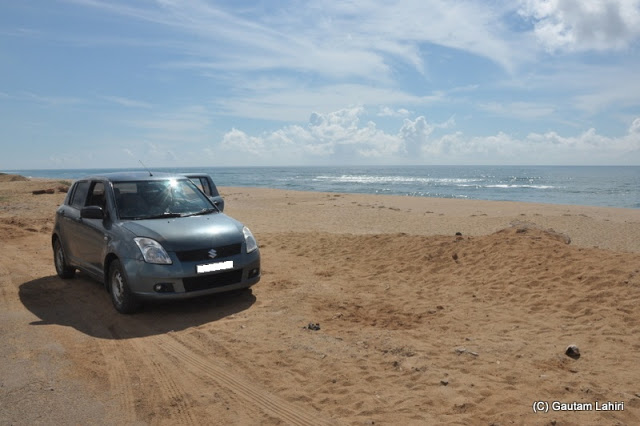 Having parked on the sand, we kept on looking at the sea atop a sand dune as waves of salty air swept over us at Puri, Bhubaneshwar, Odisha, India by Gautam Lahiri