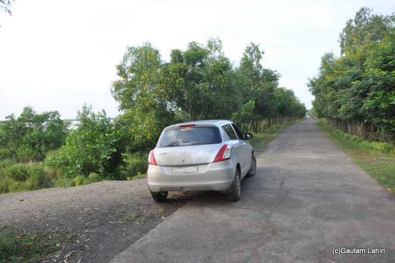 Our car, Swift parked beside the crocodile infested Brahmani river taken Gautam Lahiri