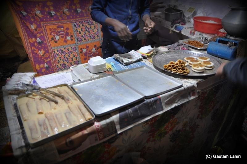 'Pithe' on offer, taste from the heavens at Santiniketan, West Bengal, India by Gautam Lahiri