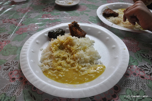 White rice, lentils, a slice of Rohu fish and Brinjal (eggplant) fry and they were so delicious at Taki, West Bengal, India by Gautam Lahiri