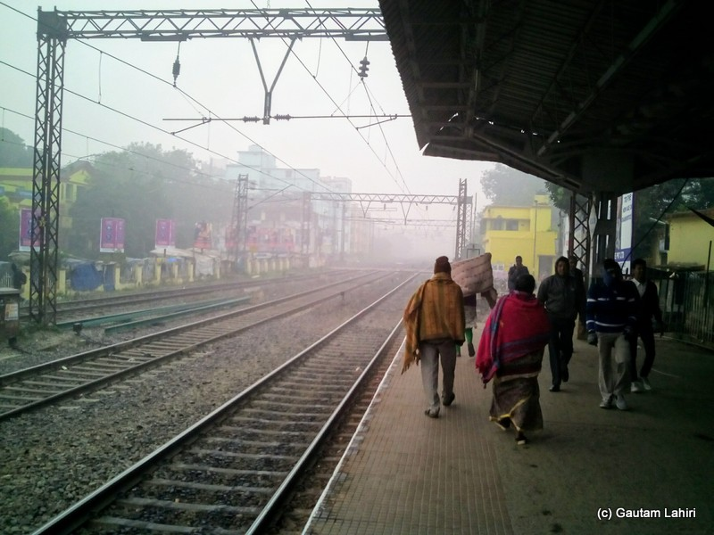 Even at six in the morning, the platform was packed with commuters at Uttarpara station by Gautam Lahiri