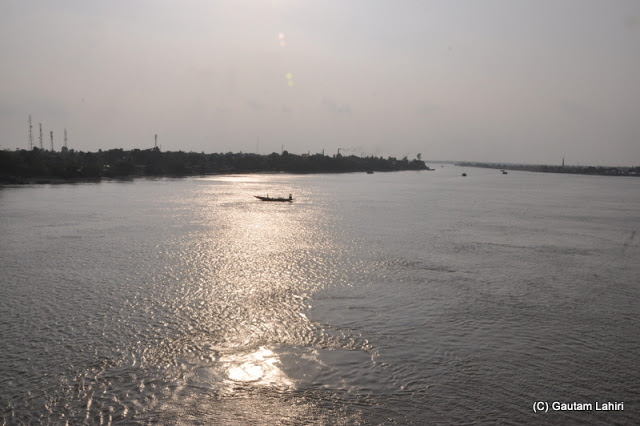 Crossing the Vidyadhari river which was glistening in the setting sun as we returned from Taki, West Bengal, India by Gautam Lahiri