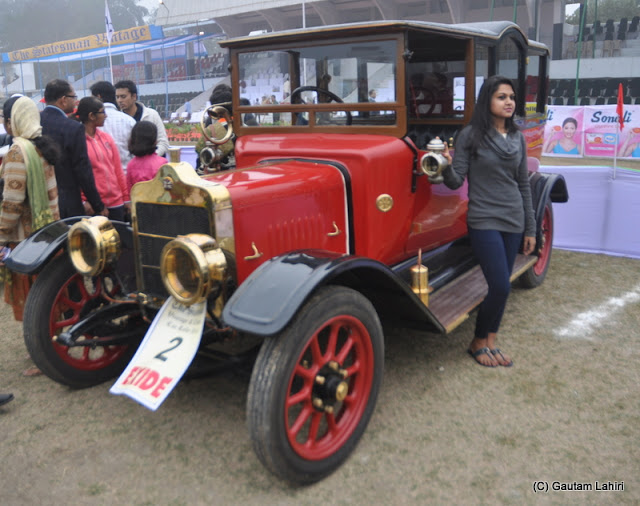A 1912 Coventry having 20 HP, and 4 cylinders wait to be fired up. Everyone wants to pose with her  at Kolkata, West Bengal, India by Gautam Lahiri