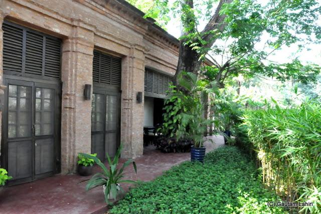 The outhouse in the garden among the trees at Bawali Rajbari, Kolkata, West Bengal, India by Gautam Lahiri
